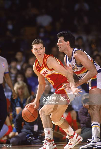 Alexander Volkov of the Atlanta Hawks dribbles the ball during the NBA game against the Golden State Warriors at the Oakland Coliseum in Oakland...