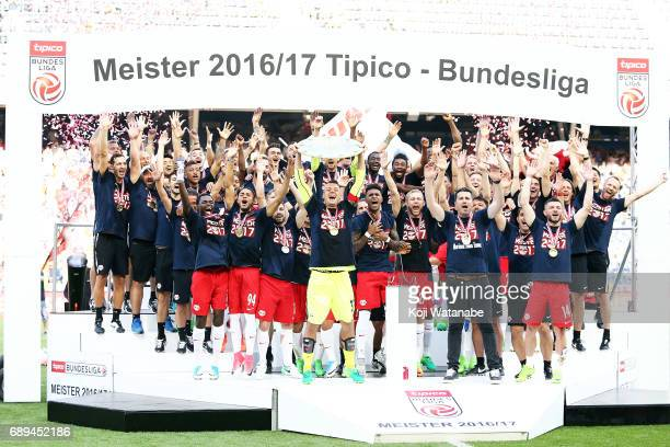 Alexander Walke of Red Bull Salzburg players celebrate with the trophy during the Austrian Bundesliga match between Red Bull Salzburg and Cashpoint...