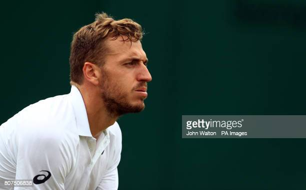 Alexander Ward in action against Kyle Edmund on day two of the Wimbledon Championships at The All England Lawn Tennis and Croquet Club Wimbledon