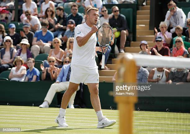 Alexander Ward of Great Britain celebrates winning a point during the Men's Singles first round against David Goffin of Belgium in the Men's Singles...