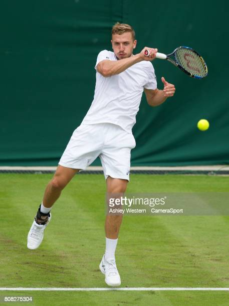 Alexander Ward of Great Britain in action against Kyle Edmund of Great Britain in their Mens Singles First Round Match at Wimbledon on July 4 2017 in...
