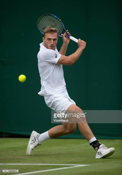 Alexander Ward of Great Britain in actiona against Kyle Edmund of Great Britain on day two of the Wimbledon Lawn Tennis Championships at the All...