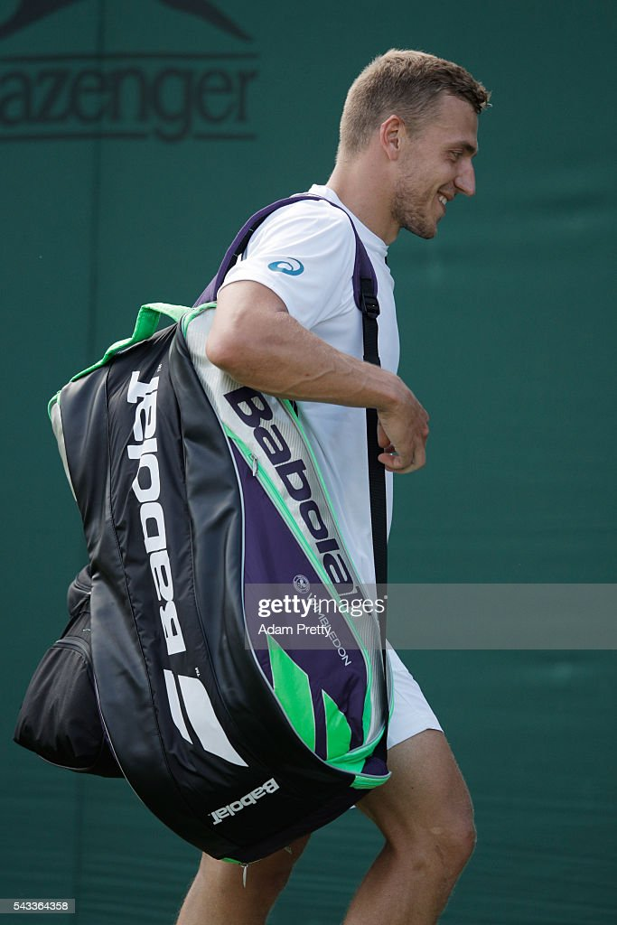 Alexander Ward of Great Britain leaves the court following defeat to David Goffin of Belgium in the Men's Singles first round match on day one of the Wimbledon Lawn Tennis Championships at the All England Lawn Tennis and Croquet Club on June 27th, 2016 in London, England.