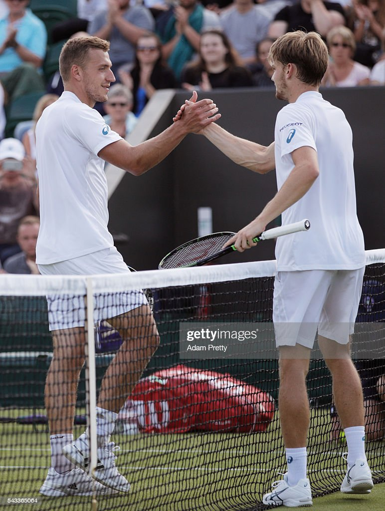 Alexander Ward of Great Britain shakes hands with David Goffin of Belgium in the Men's Singles first round match on day one of the Wimbledon Lawn Tennis Championships at the All England Lawn Tennis and Croquet Club on June 27th, 2016 in London, England.