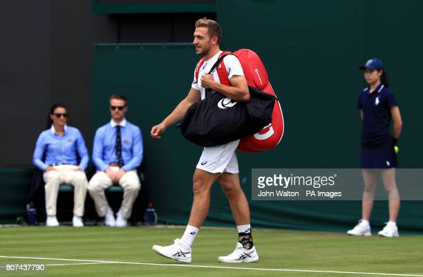 Alexander Ward walks out onto court for his match against Kyle Edmund on day two of the Wimbledon Championships at The All England Lawn Tennis and...
