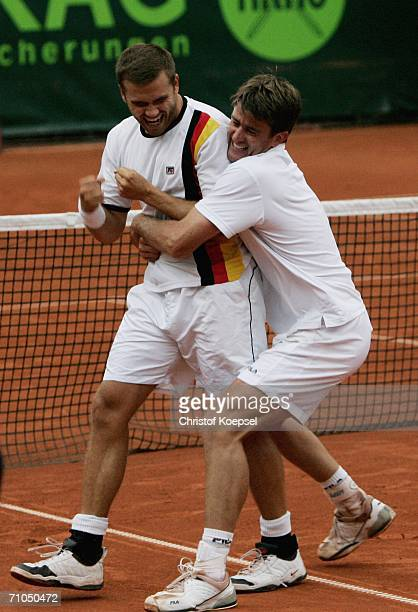 Alexander Waske and Michael Kohlmann of Germany celebrate the 64 67 and 105 victory and the qualification for the final against Tomas Berdych and...