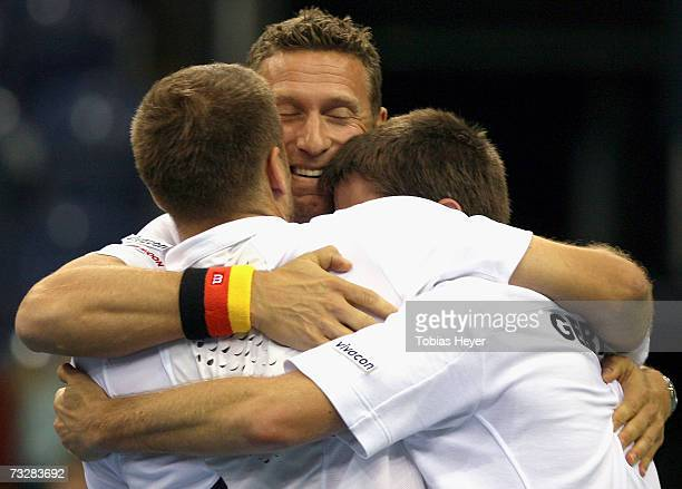 Alexander Waske coach Patrick Kuehnen and Michael Kohlmann celebrate the 30 win after the Davis Cup doubles match between Germany and Croatia at the...