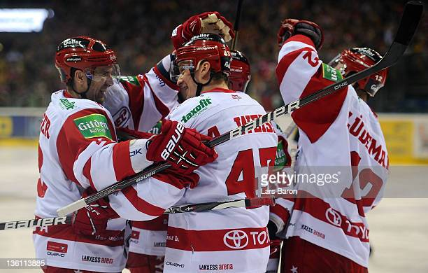 Alexander Weiss of Koeln celebrates after scoring his teams third goal during the DEL match between DEG Metro Stars and Koelner Haie at ISS Dome on...