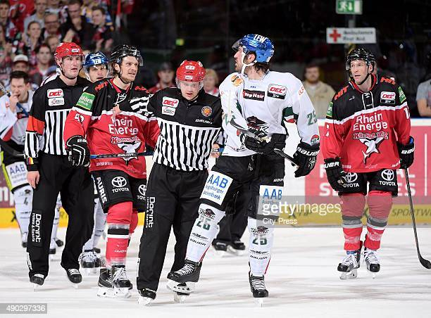Alexander Weiss of the Koelner Haie and Mark Mancari of the Augsburger Panther during the DEL game between Koelner Haie and the Augsburger Panther on...