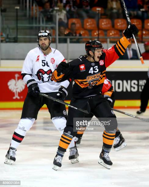 Alexander Weiss of Wolfsburg celebrates after he scores the 4th goal during the Champions Hockey League match between Grizzlys Wolfsburg and HC05...