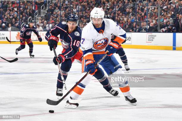 Alexander Wennberg of the Columbus Blue Jackets attempts to lift the stick of Jordan Eberle of the New York Islanders during the second period of a...