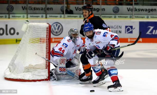 Alexander Wiess of Wolfsburg and Mark Stuart of Mannheim battle for the puck during the DEL match between Grizzlys Wolfsburg and Adler Mannheim at...