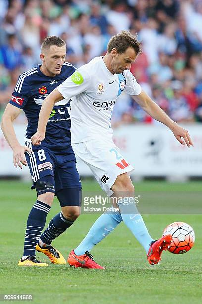 Alexander Wilkinson of the City kicks the ball away from Besart Berisha of the Victory during the round 19 ALeague match between Melbourne City FC...