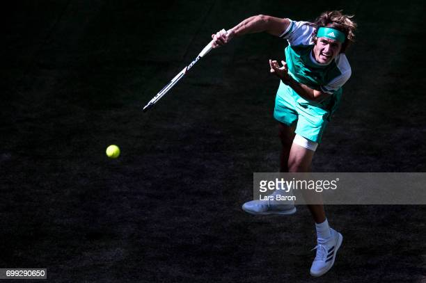 Alexander Zerev of Germany serves during his match against Philipp Kohlschreiber of Germany during Day 5 of the Gerry Weber Open 2017 at Gerry Weber...