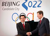 Alexander Zhukov head of the 2022 Evaluation Commission for the International Olympic Committee at right shakes hands with Wang Anshun at left mayor...