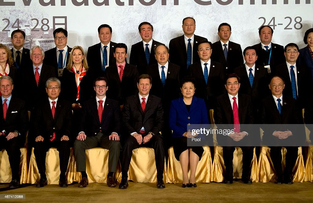 Alexander Zhukov, head of the 2022 Evaluation Commission for the International Olympic Committee (IOC), fourth from left in bottom row, and Chinese Vice Premier <a gi-track='captionPersonalityLinkClicked' href=/galleries/search?phrase=Liu+Yandong&family=editorial&specificpeople=4375362 ng-click='$event.stopPropagation()'>Liu Yandong</a>, third from right in bottom row, pose for a group photo with members of the IOC's 2022 Evaluation Commission and Beijing's 2022 Winter Olympics bid committee on March 24, 2015 in Beijing, China.