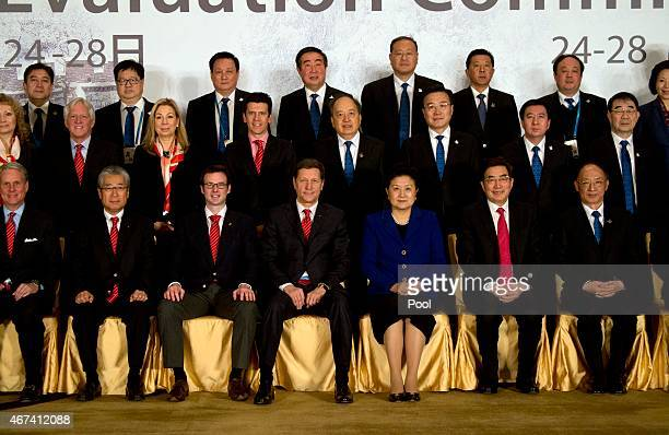Alexander Zhukov head of the 2022 Evaluation Commission for the International Olympic Committee fourth from left in bottom row and Chinese Vice...