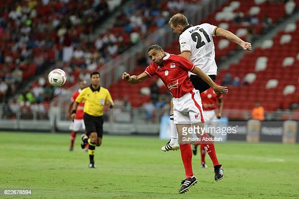 Alexander Zickler of Germany and Des Walker of England challenge for the ball during the Battle of Europe match between England Masters and Germany...