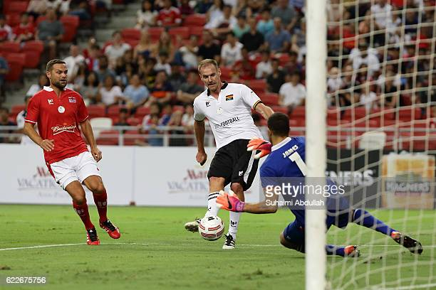 Alexander Zickler of Germany tries to shoot past David James of England during the Battle of Europe match between England Masters and Germany Masters...