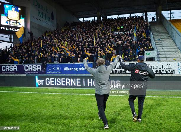 Alexander Zorniger head coach of Brondby IF and Tamas Bodog assistant coach of Brondby IF celebrate with the fans after the Danish Alka Superliga...