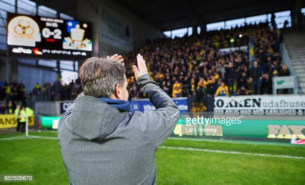 Alexander Zorniger head coach of Brondby IF celebrates with the fans after the Danish Alka Superliga match between AC Horsens and Brondby IF at Casa...