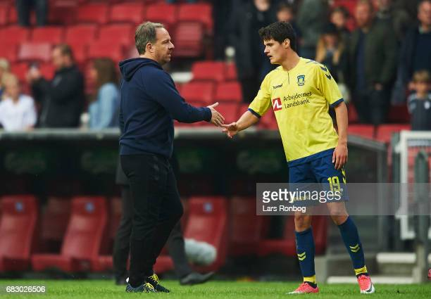 Alexander Zorniger head coach of Brondby IF shake hands with Christian Norgaard of Brondby IF after the Danish Alka Superliga match between FC...