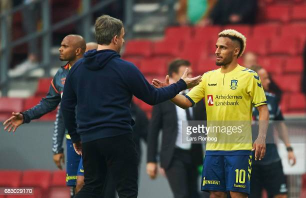 Alexander Zorniger head coach of Brondby IF shakes hands with Hany Mukhtar of Brondby IF after the Danish Alka Superliga match between FC Copenhagen...