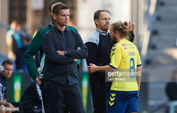 Alexander Zorniger head coach of Brondby IF shakes hands with Kasper Fisker of Brondby IF during the UEFA Europa League Qualification match between...