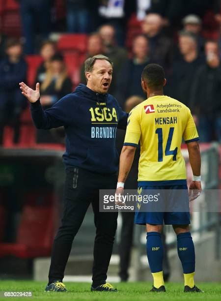 Alexander Zorniger head coach of Brondby IF speaks to Kevin Mensah of Brondby IF after the Danish Alka Superliga match between FC Copenhagen and...
