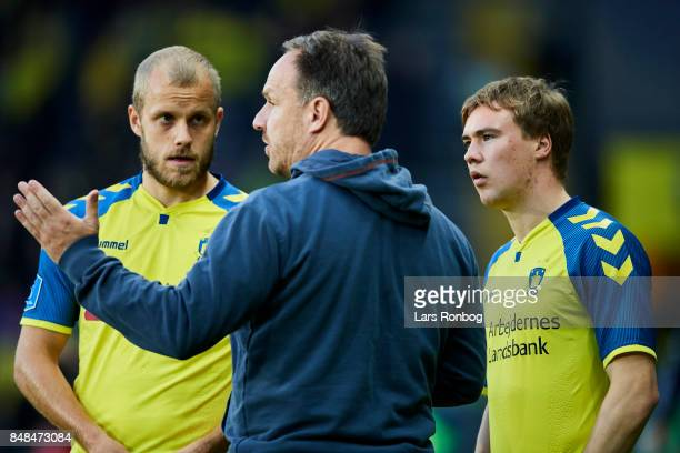 Alexander Zorniger head coach of Brondby IF speaks to Teemu Pukki and Simon Tibbling of Brondby IF during the Danish Alka Superliga match between...
