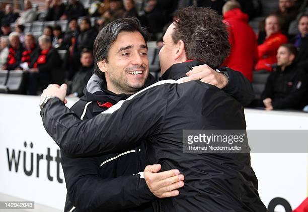 Alexander Zorniger head coach of Grossaspach hugs Oscar Corrochano head coach of Frankfurt prior to the Regionalliga Sued match between SG Sonnenhof...