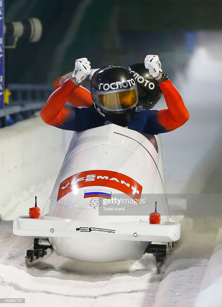 Alexander Zubkov and Dmitry Trunenkov of Russia react to their run in the men's 2 man bobsleigh event during the 2013 IBSF World Cup race November 29, 2013 in Calgary, Alberta, Canada.