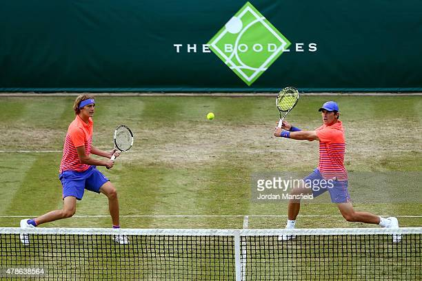 Alexander Zverev and Mischa Zverev of Germany in action during their Men's Doubles match against Mike Bryan and Rob Bryan of the USA during Day 4 of...
