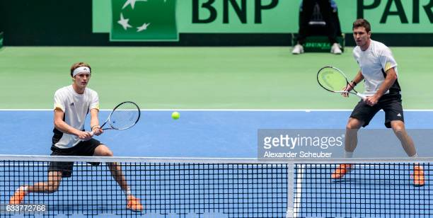 Alexander Zverev of Germany and Mischa Zverev of Germany in action against Ruben Bemelmans of Belgium and Joris De Loore of Belgium during day two of...
