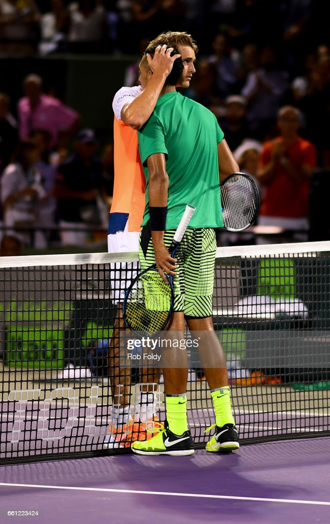 Alexander Zverev of Germany and Nick Kyrgios of Australia embrace after a match on day 11 of the Miami Open at the Crandon Park Tennis Center on March 30, 2017 in Key Biscayne, Florida.