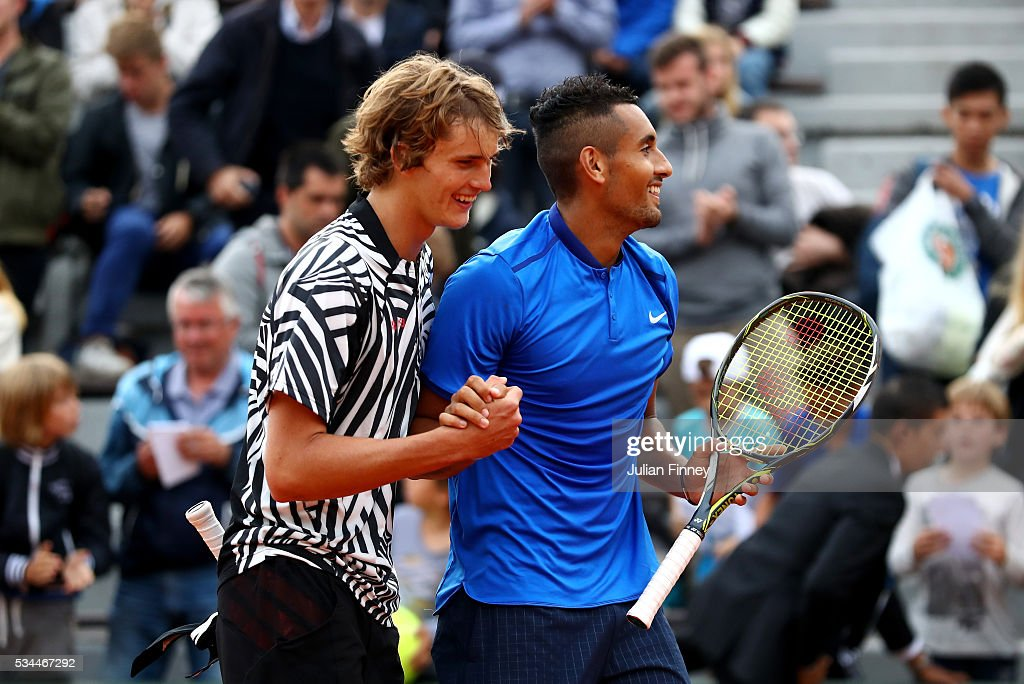 <a gi-track='captionPersonalityLinkClicked' href=/galleries/search?phrase=Alexander+Zverev+-+Tennisspieler&family=editorial&specificpeople=11367343 ng-click='$event.stopPropagation()'>Alexander Zverev</a> of Germany and <a gi-track='captionPersonalityLinkClicked' href=/galleries/search?phrase=Nick+Kyrgios&family=editorial&specificpeople=6705178 ng-click='$event.stopPropagation()'>Nick Kyrgios</a> of Australia following their victory during the Men's Singles second round match against Pablo Carreno Busta and David Marrero of Spain on day five of the 2016 French Open at Roland Garros on May 26, 2016 in Paris, France.