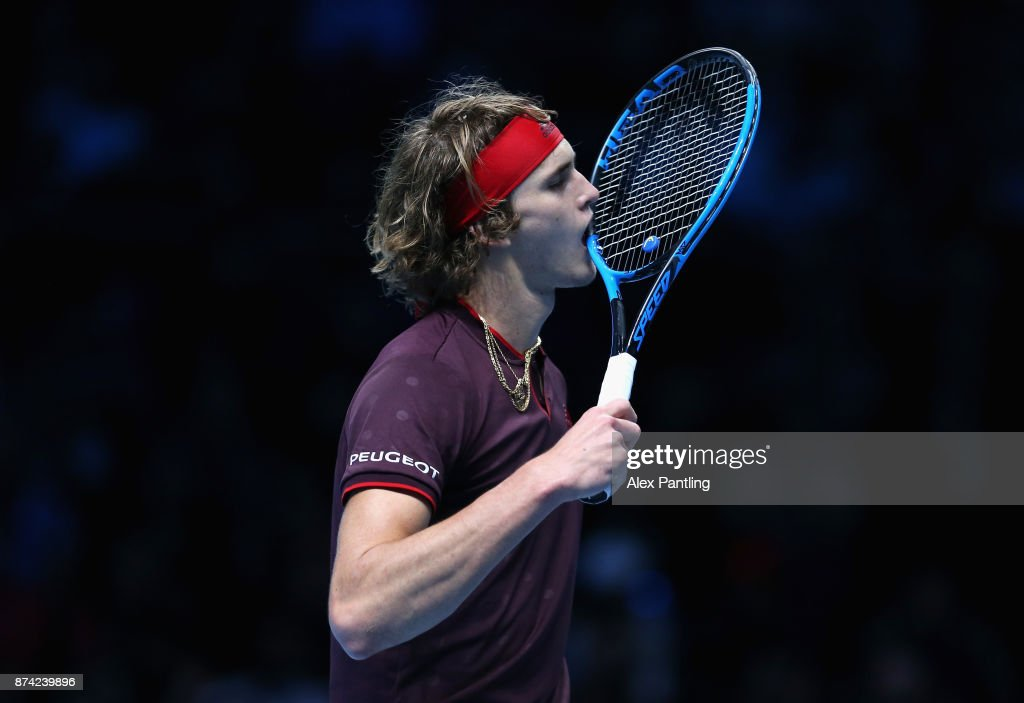 Alexander Zverev of Germany bites his racket in frustraion during the singles match against Roger Federer of Switzerland on day three of the Nitto ATP World Tour Finals at O2 Arena on November 14, 2017 in London, England.