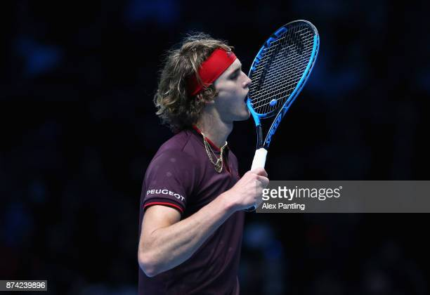 Alexander Zverev of Germany bites his racket in frustraion during the singles match against Roger Federer of Switzerland on day three of the Nitto...