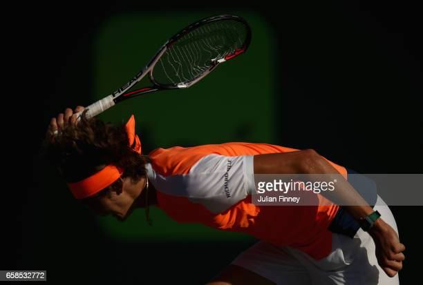 Alexander Zverev of Germany brakes his racket in frustration in his match against John Isner of USA at Crandon Park Tennis Center on March 27 2017 in...