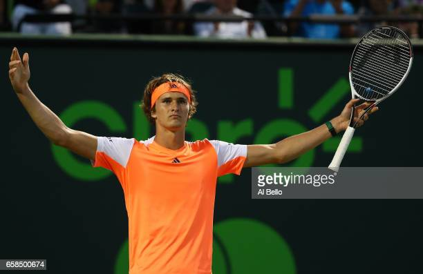 Alexander Zverev of Germany celebrates match point against John Isner during Day 8 of the Miami Open at Crandon Park Tennis Center on March 27 2017...