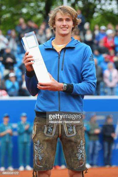 Alexander Zverev of Germany celebrates vwith the BMW Open by FWU winner's trophy after winning his finale match against Guido Pella of Argentina of...