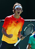 Alexander Zverev of Germany celebrates winning a point in his match against Ivan Dodig of Croatia during day five of the BNP Paribas Open at Indian...