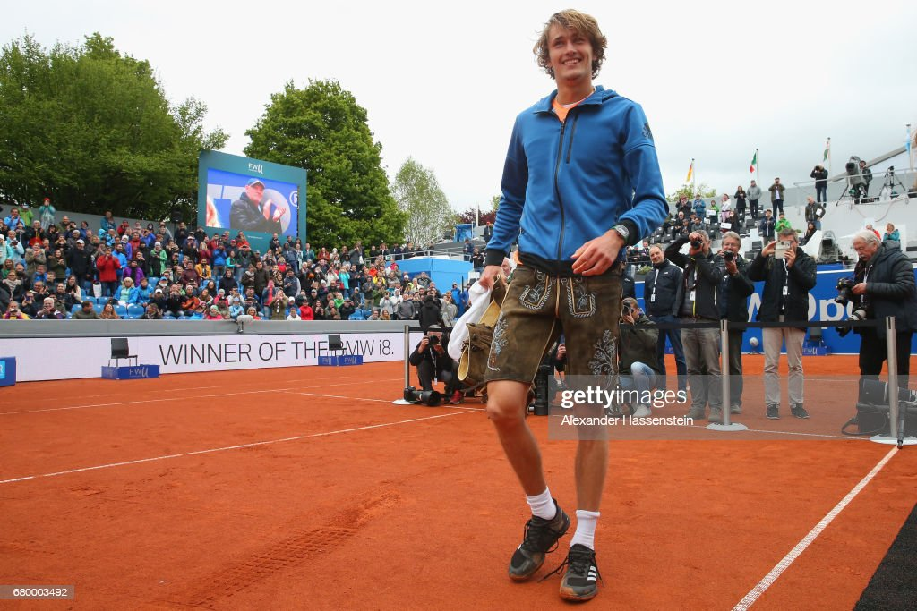 Alexander Zverev of Germany celebrates with Bavarian leather pants after winning his finale match against Guido Pella of Argentina of the 102. BMW Open by FWU at Iphitos tennis club on May 7, 2017 in Munich, Germany.