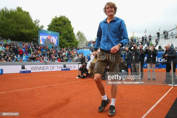 Alexander Zverev of Germany celebrates with Bavarian leather pants after winning his finale match against Guido Pella of Argentina of the 102 BMW...