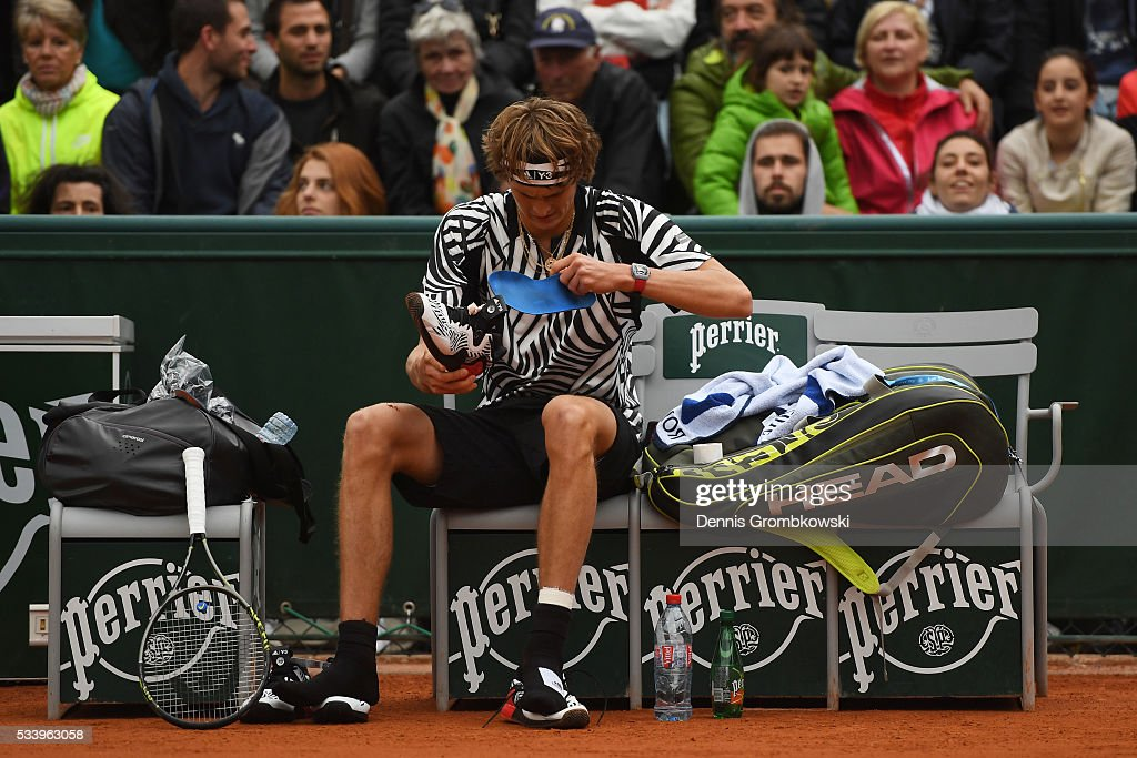 <a gi-track='captionPersonalityLinkClicked' href=/galleries/search?phrase=Alexander+Zverev+-+Tennista&family=editorial&specificpeople=11367343 ng-click='$event.stopPropagation()'>Alexander Zverev</a> of Germany changes his shoes during the Men's Singles first round match against Pierre-Hughes Herbert of France on day three of the 2016 French Open at Roland Garros on May 24, 2016 in Paris, France.
