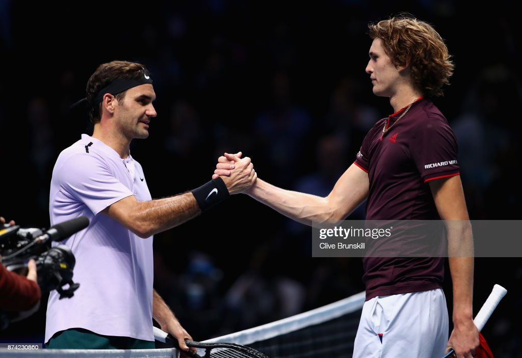 Alexander Zverev of Germany congratulates Roger Federer of Switzerland on victory follwing their singles match on day three of the Nitto ATP World Tour Finals at O2 Arena on November 14, 2017 in London, England.