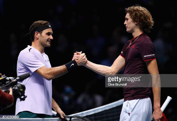 Alexander Zverev of Germany congratulates Roger Federer of Switzerland on victory follwing their singles match on day three of the Nitto ATP World...