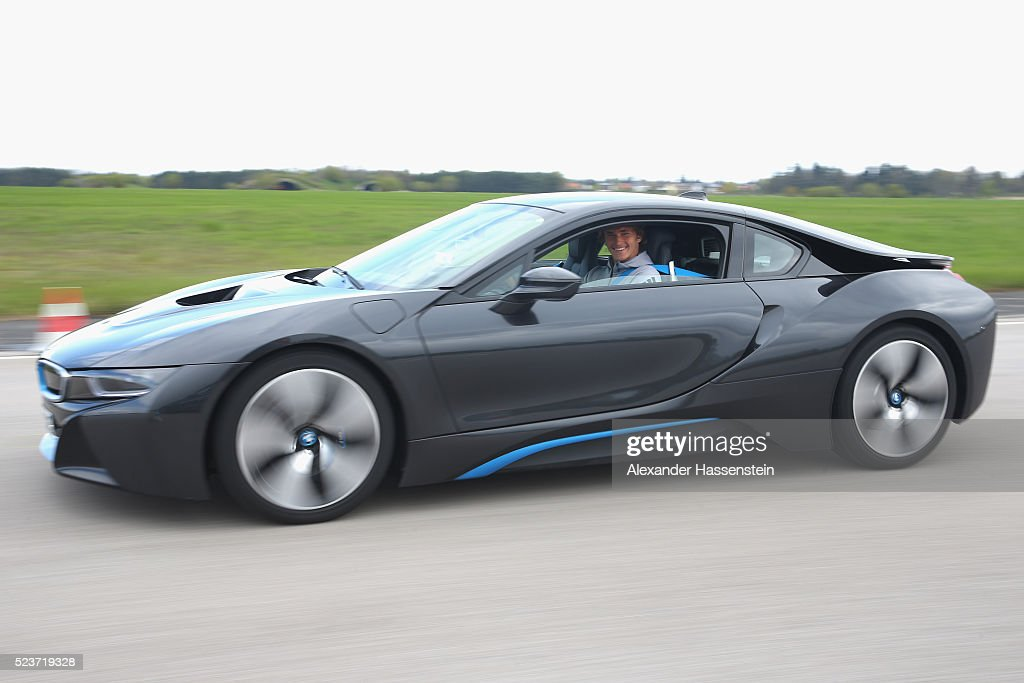 Alexander Zverev of Germany drives a BMW i8 at the BMW DrivingExperience at BMW driving academy Maisach ahead of the BMW Open at Iphitos tennis club...