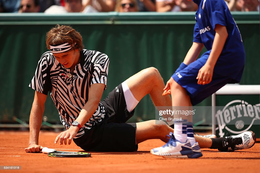 <a gi-track='captionPersonalityLinkClicked' href=/galleries/search?phrase=Alexander+Zverev+-+Tennisser&family=editorial&specificpeople=11367343 ng-click='$event.stopPropagation()'>Alexander Zverev</a> of Germany falls during the Men's Singles first round match against Pierre-Hughers Herbert of France on day four of the 2016 French Open at Roland Garros on May 25, 2016 in Paris, France.