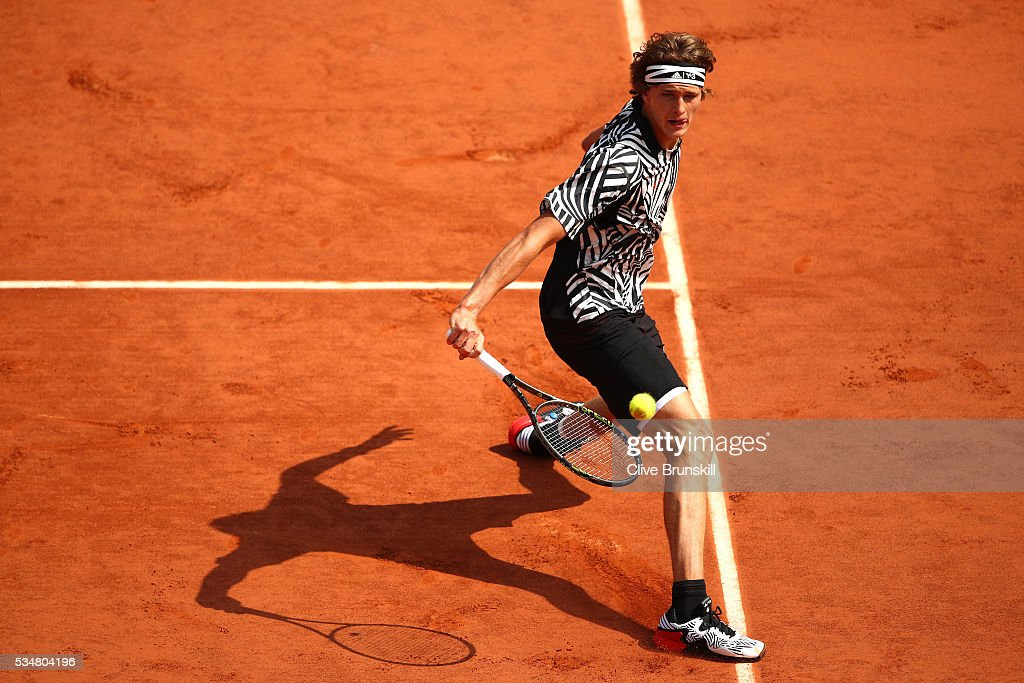 <a gi-track='captionPersonalityLinkClicked' href=/galleries/search?phrase=Alexander+Zverev+-+Tennis+Player&family=editorial&specificpeople=11367343 ng-click='$event.stopPropagation()'>Alexander Zverev</a> of Germany hits a backhand during the Men's Singles third round match against Dominic Thiem of Austria on day seven of the 2016 French Open at Roland Garros on May 28, 2016 in Paris, France.